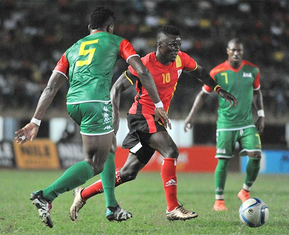 Patrick Malo of Burkina Faso challenges William Kizito Luwaga of Uganda Cranes during the 2017 Africa Cup of Nations Qualifier on 29 March 2016 at Mandela Stadium, Namboole. ©Ismail Kezaala/BackpagePix