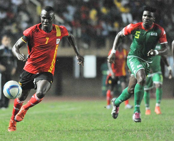 Patrick Malo of Burkina Faso challenges Emmanuel Okwi of Uganda Cranes during the 2017 Africa Cup of Nations Qualifier on 29 March 2016 at Mandela Stadium, Namboole. ©Ismail Kezaala/BackpagePix