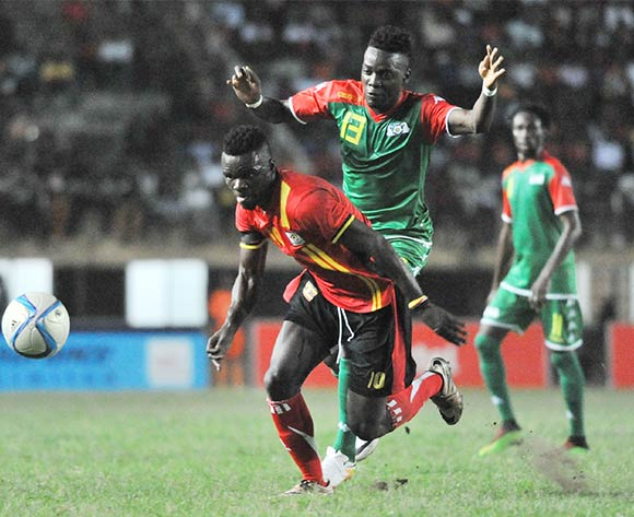 Traore Baertrand Isidora of Burkina Faso challenges William Kizito Luwaga of Uganda Cranes during the 2017 Africa Cup of Nations Qualifier on 29 March 2016 at Mandela Stadium, Namboole. ©Ismail Kezaala/BackpagePix