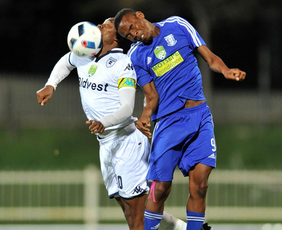 Sibusiso Vilakazi (l) of Bidvest Wits challenged by Oupa Seete (r) of Magesi FC during the 2016 Nedbank Cup last 16 match between Magesi FC and Bidvest Wits at the Old Peter Mokaba Stadium in Polokwane, South Africa on April 01, 2016 ©Samuel Shivambu/BackpagePix