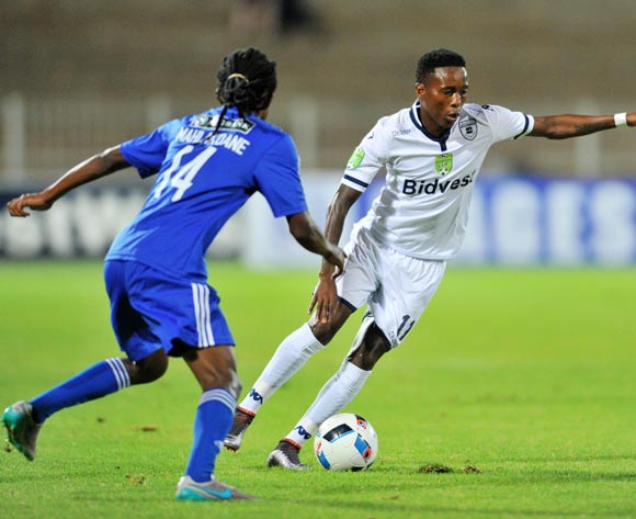 Elias Pelembe (r) of Bidvest Wits challenged by Dibate Mahlakoane (l) of Magesi FC during the 2016 Nedbank Cup last 16 match between Magesi FC and Bidvest Wits at the Old Peter Mokaba Stadium in Polokwane, South Africa on April 01, 2016 ©Samuel Shivambu/BackpagePix