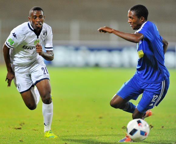 Siyabonga Nhlapho (l) of Bidvest Wits challenged by Francious Baloyi (r) of Magesi FC during the 2016 Nedbank Cup last 16 match between Magesi FC and Bidvest Wits at the Old Peter Mokaba Stadium in Polokwane, South Africa on April 01, 2016 ©Samuel Shivambu/BackpagePix