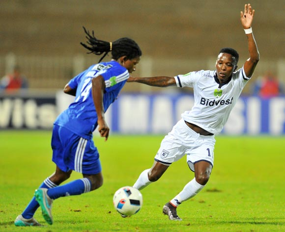 Dibate Mahlakoane (l) of Magesi FC challenged by Elias Pelembe (r) of Bidvest Wits during the 2016 Nedbank Cup last 16 match between Magesi FC and Bidvest Wits at the Old Peter Mokaba Stadium in Polokwane, South Africa on April 01, 2016 ©Samuel Shivambu/BackpagePix