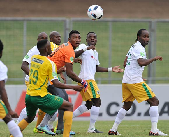 Oscarine Masuluke of Baroka challenged by Quincy Ngcobo of Golden Arrows (29) during the 2016 Nedbank Cup match between Golden Arrows and Baroka at Chatsworth Stadium, Chatsworth Kwa-Zulu Natal on 03 April 2016 ©Muzi Ntombela/Backpagepix