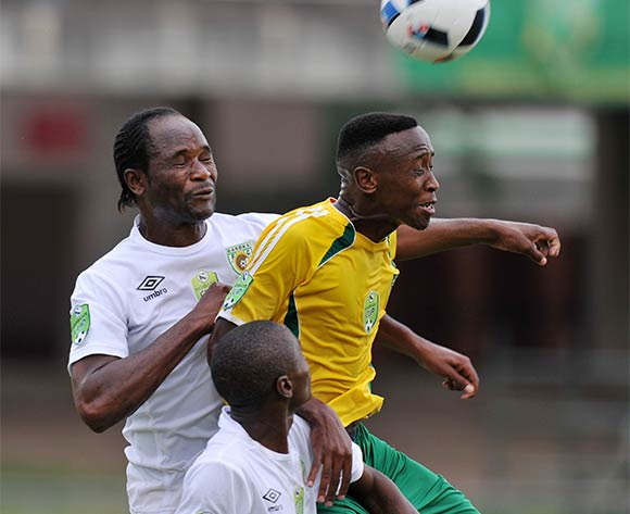Quincy Ngcobo of Golden Arrows challenged by Caswell Chauke of Baroka during the 2016 Nedbank Cup match between Golden Arrows and Baroka at Chatsworth Stadium, Chatsworth Kwa-Zulu Natal on 03 April 2016 ©Muzi Ntombela/Backpagepix