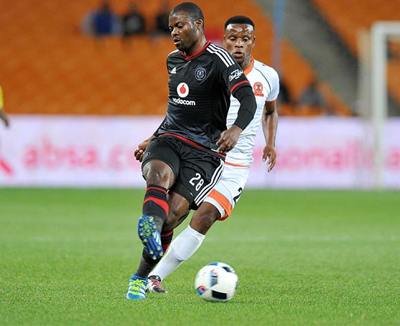 Rooi Mahamutsa of Orlando Pirates challenged by Thobani Mncwango of Polokwane City during the Absa Premiership 2015/16 match between Orlando Pirates and Polokwane City at FNB Stadium in Johannesburg, South Africa on April 27, 2016 ©Muzi Ntombela/BackpagePix