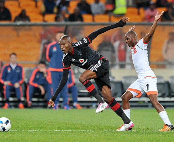 Tendai Ndoro of Orlando Pirates fouled by Sipho Jembula of Polokwane City during the Absa Premiership 2015/16 match between Orlando Pirates and Polokwane City at FNB Stadium in Johannesburg, South Africa on April 27, 2016 ©Muzi Ntombela/BackpagePix