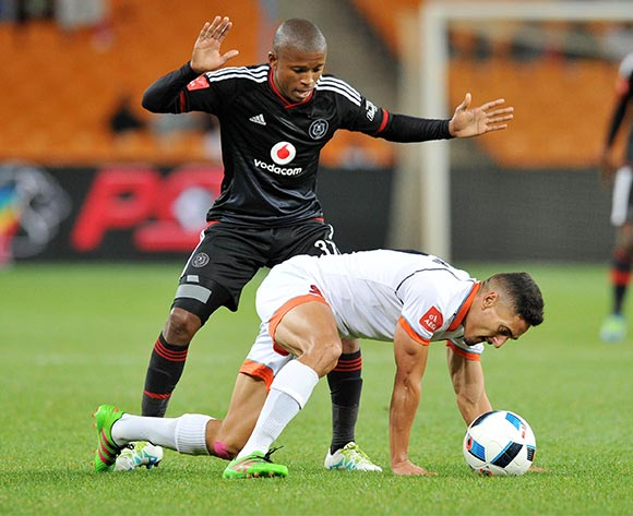 Cole Alexander of Polokwane City shields ball from Luvuyo Memela of Orlando Pirates during the Absa Premiership 2015/16 match between Orlando Pirates and Polokwane City at FNB Stadium in Johannesburg, South Africa on April 27, 2016 ©Muzi Ntombela/BackpagePix