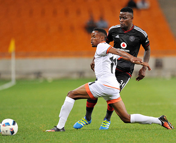 Ntsikelelo Nyauza of Orlando Pirates challenged by Jorry Matjila of Polokwane City during the Absa Premiership 2015/16 match between Orlando Pirates and Polokwane City at FNB Stadium in Johannesburg, South Africa on April 27, 2016 ©Muzi Ntombela/BackpagePix