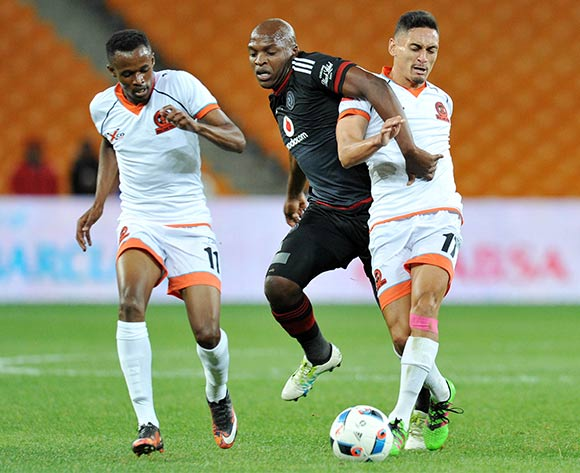 Gift Motupa of Orlando Pirates challenged by Cole Alexander (r) and Jorry Matjila of Polokwane City during the Absa Premiership 2015/16 match between Orlando Pirates and Polokwane City at FNB Stadium in Johannesburg, South Africa on April 27, 2016 ©Muzi Ntombela/BackpagePix