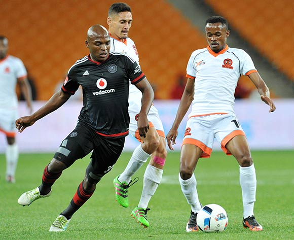 Jorry Matjila and Cole Alexander of Polokwane City challenged by Gift Motupa of Orlando Pirates during the Absa Premiership 2015/16 match between Orlando Pirates and Polokwane City at FNB Stadium in Johannesburg, South Africa on April 27, 2016 ©Muzi Ntombela/BackpagePix