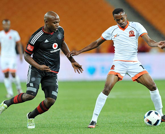 Jorry Matjila of Polokwane City challenged by Gift Motupa of Orlando Pirates during the Absa Premiership 2015/16 match between Orlando Pirates and Polokwane City at FNB Stadium in Johannesburg, South Africa on April 27, 2016 ©Muzi Ntombela/BackpagePix