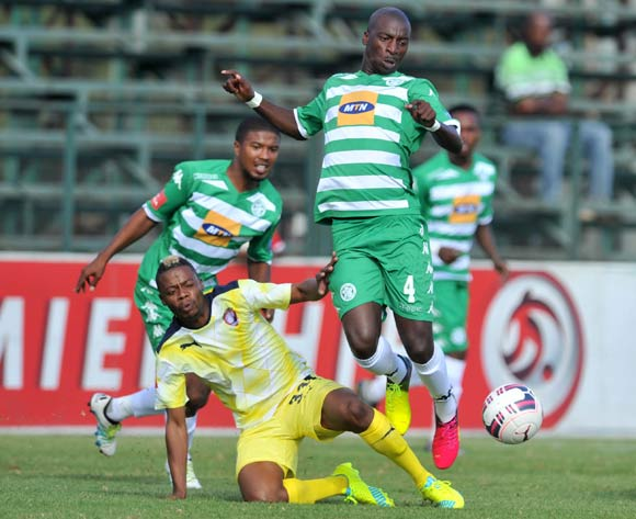 Musa Nyatama of Bloemfontein Celtic challenged by Pentjie Zulu of Jomo Cosmos during the Absa Premiership match between Jomo Cosmos and Bloemfontein Celtic at the Olen Park Stadium in Pochestroom, South Africa on April 27, 2016 ©Samuel Shivambu/BackpagePix