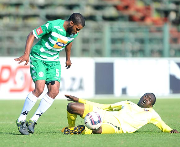Charlton Mashumba of Jomo Cosmos challenged by Wandisile Letlabika of Bloemfontein Celtic during the Absa Premiership match between Jomo Cosmos and Bloemfontein Celtic at the Olen Park Stadium in Pochestroom, South Africa on April 27, 2016 ©Samuel Shivambu/BackpagePix