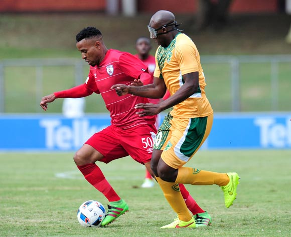 Nhlanhla Vilakazi of Free State Stars challenged by Musa Bilankulu of Golden Arrows during the Absa Premiership 2015/16 match between Golden Arrows and Free State Stars at Chatsworth Stadium in Chatsworth, South Africa on April 30, 2016 ©Muzi Ntombela/BackpagePix