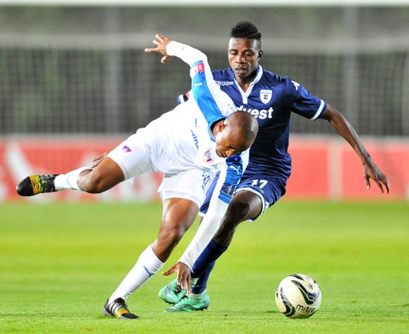 Xola Mlambo of Chippa United challenged by Papy Faty of Bidvest Wits during the Absa Premiership match between Bidvest Wits and Chippa United at the Bidvest Stadium in Johannesburg, South Africa on April 30, 2016 ©Samuel Shivambu/BackpagePix