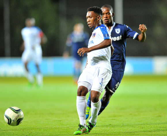 Buyani Sali of Chippa United challenged by Phumlani Ntshangase of Bidvest Wits during the Absa Premiership match between Bidvest Wits and Chippa United at the Bidvest Stadium in Johannesburg, South Africa on April 30, 2016 ©Samuel Shivambu/BackpagePix