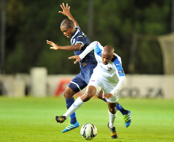 Xola Mlambo of Chippa United challenged by Phumlani Ntshangase of Bidvest Wits during the Absa Premiership match between Bidvest Wits and Chippa United at the Bidvest Stadium in Johannesburg, South Africa on April 30, 2016 ©Samuel Shivambu/BackpagePix