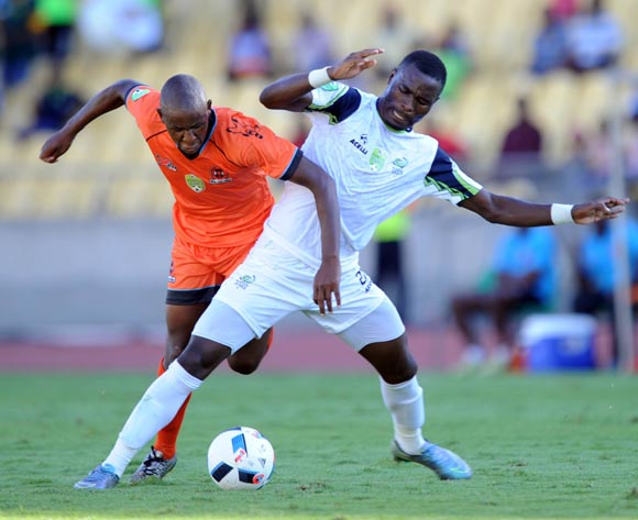 Robert Ngambi of Platinum Stars is challenged by Lebohang Motumi of Polokwane City during the Nedbank Cup Last 16 match between Platinum Stars and Polokwane City on 02 April 2016 at Royal Bafokeng Stadium Pic Sydney Mahlangu/ BackpagePix