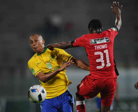 Wayne Arendse of Mamelodi Sundowns challenges Sifiso Thomo of Mbombela United during the Nedbank Cup Last 16 match between Mamelodi Sundowns and Mbombela United on 02 April 2016 at Lucas Moripe Stadium Pic Sydney Mahlangu/ BackpagePix