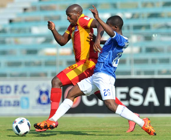 Tumelo Mogapi (l) of Maritzburg United challenged by Thabo Nodaba (r) of Black Aces during the 2016 Nedbank Cup last 16 match between Black Aces and Maritzburg United at the Kanyamazane Stadium in Nelspruit, South Africa on April 02, 2016 ©Samuel Shivambu/BackpagePix