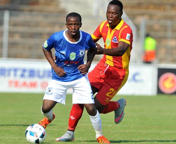Thabo Nodaba (l) of Black Aces challenged by Philani Zulu (r) of Maritzburg United during the 2016 Nedbank Cup last 16 match between Black Aces and Maritzburg United at the Kanyamazane Stadium in Nelspruit, South Africa on April 02, 2016 ©Samuel Shivambu/BackpagePix