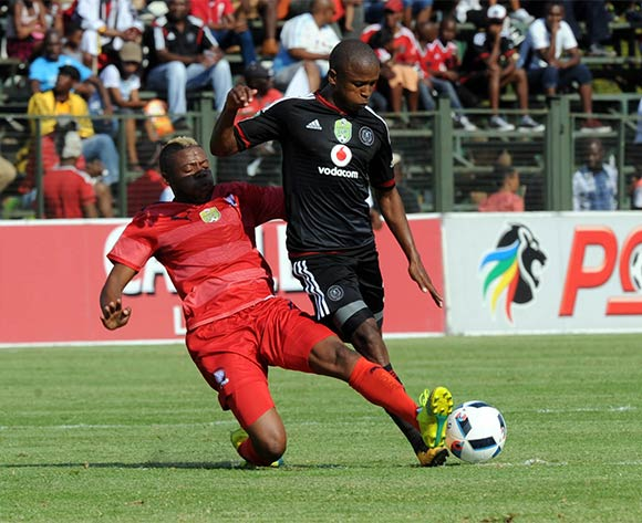 Luvuyo Memela of Orlando Piratesis challenged by Pentjie Zulu of  Jomo Cosmos during the Nedbank Cup Last 16 match between Jomo Cosmos and Orlando Pirates on 03 April 2016 at Olen Park Stadium Pic Sydney Mahlangu/ BackpagePix