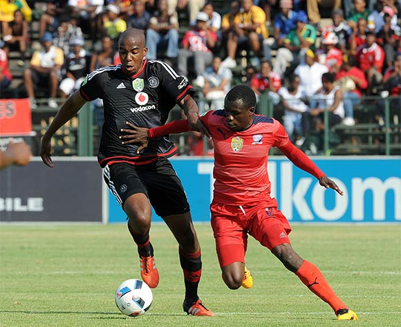 Lehlohonolo Masalesa of Orlando Pirates challenges Charlton Mashumba of  Jomo Cosmos during the Nedbank Cup Last 16 match between Jomo Cosmos and Orlando Pirates on 03 April 2016 at Olen Park Stadium Pic Sydney Mahlangu/ BackpagePix