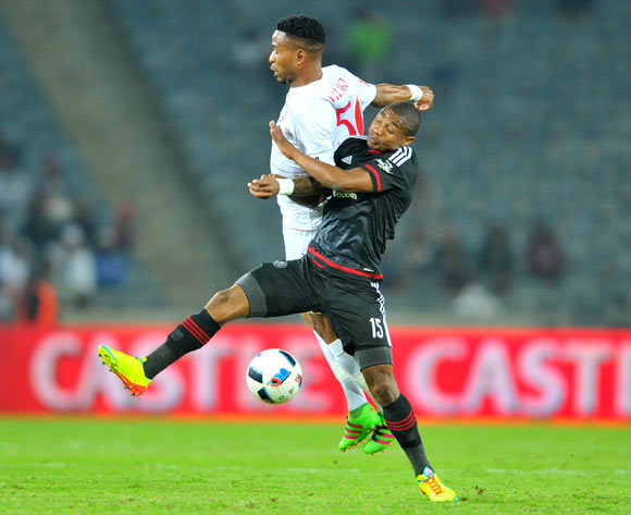 Thabo Qalinge of Orlando Pirates challenged by Nhlanhla Vilakazi of Free State Stars during the Absa Premiership match between Orlando Pirates and Free State Stars at the Orlando Stadium in Johannesburg, South Africa on April 09, 2016 ©Samuel Shivambu/BackpagePix