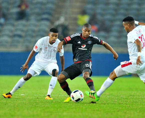 Thabo Qalinge (c) of Orlando Pirates challenged by Bokang Tlhone (l) and Nhlanhla Vilakazi (r) of Free State Stars during the Absa Premiership match between Orlando Pirates and Free State Stars at the Orlando Stadium in Johannesburg, South Africa on April 09, 2016 ©Samuel Shivambu/BackpagePix