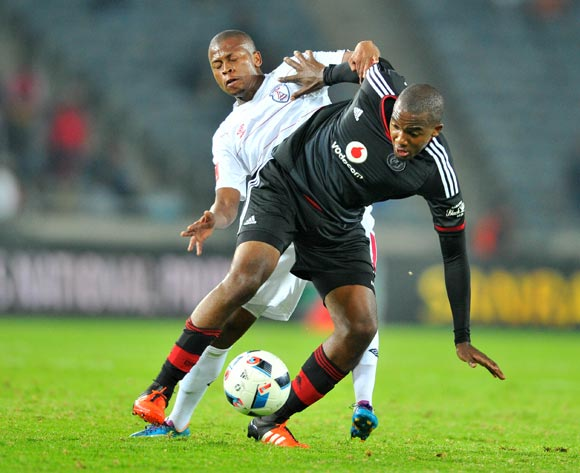Lehlohonolo Masalesa (f) of Orlando Pirates challenged by Danny Venter (b) of Free State Stars during the Absa Premiership match between Orlando Pirates and Free State Stars at the Orlando Stadium in Johannesburg, South Africa on April 09, 2016 ©Samuel Shivambu/BackpagePix