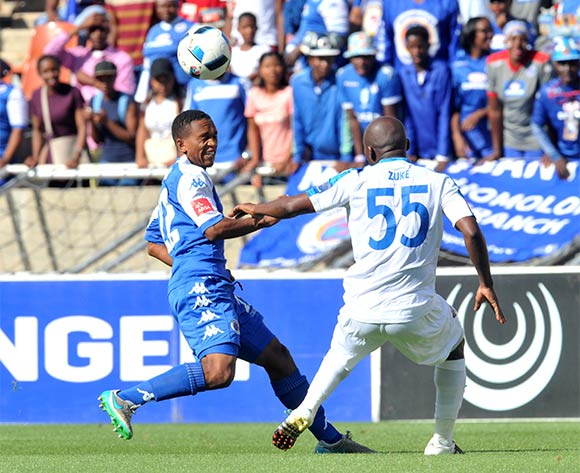 Luvolwethu Mpeta (l) of Supersport United challenged by Sandile Zuke (r) of Chippa United during the Absa Premiership match between Supersport United and Chippa United at the Peter Mokaba Stadium in Johannesburg, South Africa on April 10, 2016 ©Samuel Shivambu/BackpagePix