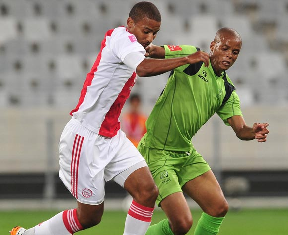 Rivaldo Coetzee of Ajax Cape Town tackled by Solomon Mathe of Platinum Stars during the Absa Premiership 2015/16 football match between Ajax Cape Town and Platinum Stars at Cape Town Stadium, Cape Town on 13 April 2016 ©Chris Ricco/BackpagePix