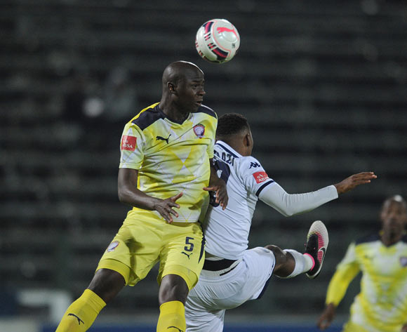Pilot Mthembu of Jomo Cosmos challenges Sibusiso Vilakazi of Bidvest Wits during the Absa Premiership match between Jomo Cosmos and Bidvest Wits on 13 April 2016 at Olen Park Stadium Pic Sydney Mahlangu/ BackpagePix