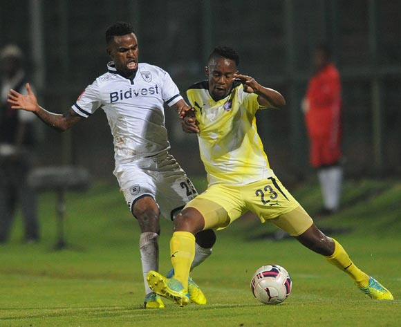 Linda Mntambo of Jomo Cosmos is challenged by Jabulani Shongwe of Bidvest Wits during the Absa Premiership match between Jomo Cosmos and Bidvest Wits on 13 April 2016 at Olen Park Stadium Pic Sydney Mahlangu/ BackpagePix