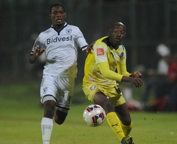 Sibusiso Khumalo of Jomo Cosmos is challenged by Phumlani Ntshangase of Bidvest Witsduring the Absa Premiership match between Jomo Cosmos and Bidvest Wits on 13 April 2016 at Olen Park Stadium Pic Sydney Mahlangu/ BackpagePix