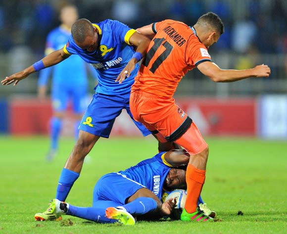 Tiyani Mabunda (l) and Ramahlwe Mphahlele (c) of Mamelodi Sundowns challenged by Cole Alexander (r) of Polokwane City during the Absa Premiership match between Polokwane City and Mamelodi Sundowns at the Old Peter Mokaba Stadium in Polokwane, South Africa on April 13, 2016 ©Samuel Shivambu/BackpagePix
