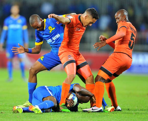 Tiyani Mabunda (l) and Ramahlwe Mphahlele (c) of Mamelodi Sundowns challenged by Cole Alexander (c) and Lebohang Motumi (r) of Polokwane City during the Absa Premiership match between Polokwane City and Mamelodi Sundowns at the Old Peter Mokaba Stadium in Polokwane, South Africa on April 13, 2016 ©Samuel Shivambu/BackpagePix