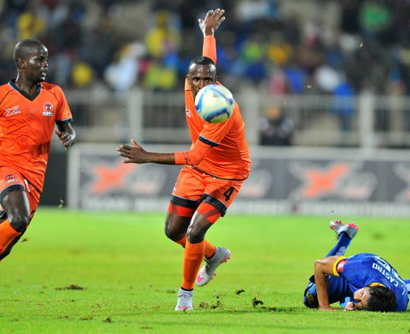 Leonardo Castro (r) of Mamelodi Sundowns challenged by Thapelo Tshilo (c) of Polokwane City during the Absa Premiership match between Polokwane City and Mamelodi Sundowns at the Old Peter Mokaba Stadium in Polokwane, South Africa on April 13, 2016 ©Samuel Shivambu/BackpagePix