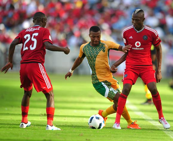 Tendai Ndoro (r) and Thabo Rakhale of Orlando Pirates challenged by Thembela Sikhakhane of Golden Arrows during the Absa Premiership 2015/16 match between Golden Arrows and Orlando Pirates at Moses Mabhida Stadium, Durban Kwa-Zulu Natal on 16 April 2016 ©Muzi Ntombela/Backpagepix