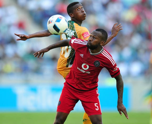 Mpho Makola of Orlando Pirates challenged by Matome Mathiane of Golden Arrows during the Absa Premiership 2015/16 match between Golden Arrows and Orlando Pirates at Moses Mabhida Stadium, Durban Kwa-Zulu Natal on 16 April 2016 ©Muzi Ntombela/Backpagepix