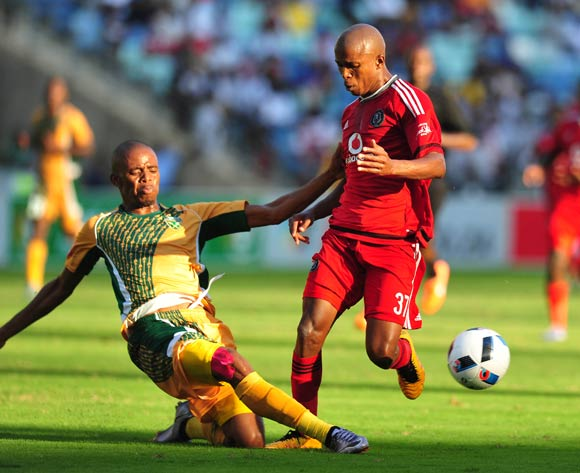 Luvuyo Memela of Orlando Pirates tackled by Gladwin Shitolo of Golden Arrows during the Absa Premiership 2015/16 match between Golden Arrows and Orlando Pirates at Moses Mabhida Stadium, Durban Kwa-Zulu Natal on 16 April 2016 ©Muzi Ntombela/Backpagepix