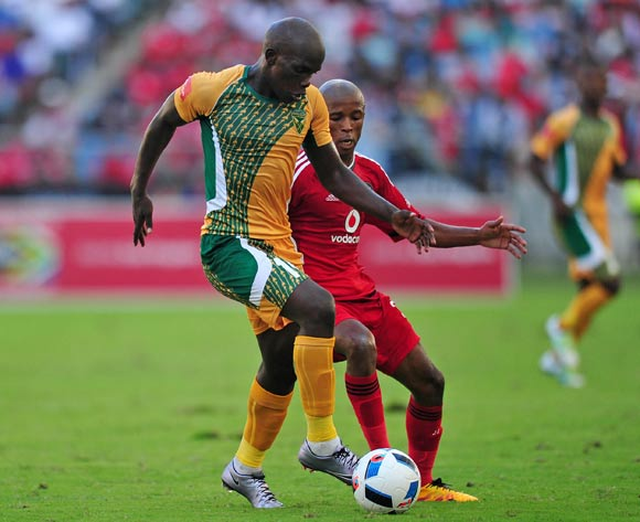 Siyabonga Dube of Golden Arrows challenged by Luvuyo Memela of Orlando Pirates during the Absa Premiership 2015/16 match between Golden Arrows and Orlando Pirates at Moses Mabhida Stadium, Durban Kwa-Zulu Natal on 16 April 2016 ©Muzi Ntombela/Backpagepix