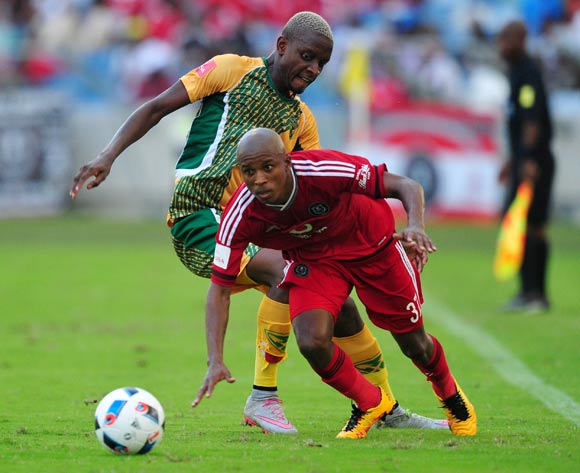Luvuyo Memela of Orlando Pirates tackled by Chris Katjiukua of Golden Arrows during the Absa Premiership 2015/16 match between Golden Arrows and Orlando Pirates at Moses Mabhida Stadium, Durban Kwa-Zulu Natal on 16 April 2016 ©Muzi Ntombela/Backpagepix