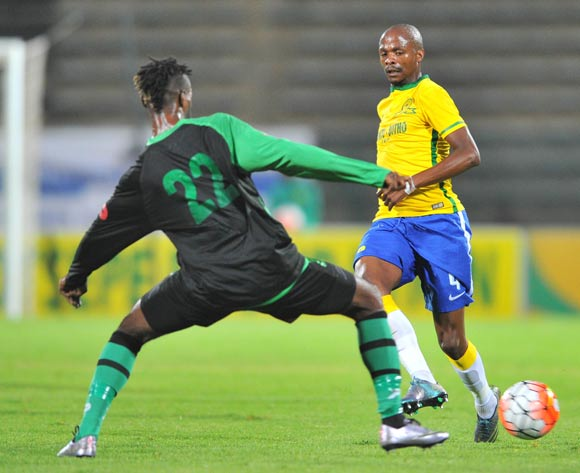 Tebogo Langerman of Mamelodi Sundowns challenged by Wango Mbambu of AS Vita during the 2016 CAF Champions League football match between Mamelodi Sundowns v AS Vita at the Lucas Moripe Stadium in Pretoria, South Africa on April 20, 2016 ©Samuel Shivambu/BackpagePix