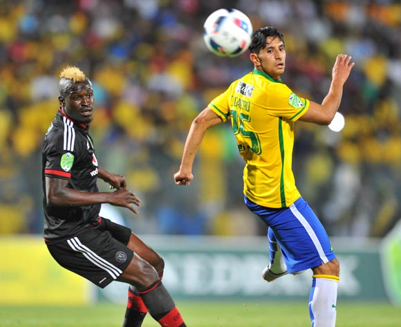 Leonardo Castro of Mamelodi Sundowns challenged by Edwin Gyimah of Orlando Pirates during the 2016 Nedbank Cup match between Mamelodi Sundowns and Orlando Pirates at the Lucas Moripe Stadium in Pretoria, South Africa on April 23, 2016 ©Samuel Shivambu/BackpagePix