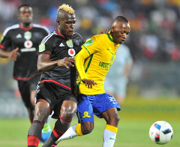 Khama Billiat of Mamelodi Sundowns challenged by Edwin Gyimah of Orlando Pirates during the 2016 Nedbank Cup match between Mamelodi Sundowns and Orlando Pirates at the Lucas Moripe Stadium in Pretoria, South Africa on April 23, 2016 ©Samuel Shivambu/BackpagePix