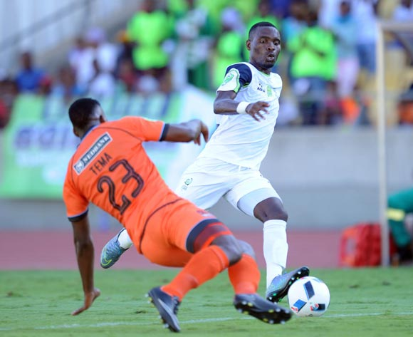 Robert Ngambi of Platinum Stars is challenged by Tshepo Tema of Polokwane City during the Nedbank Cup Last 16 match between Platinum Stars and Polokwane City on 02 April 2016 at Royal Bafokeng Stadium Pic Sydney Mahlangu/ BackpagePix