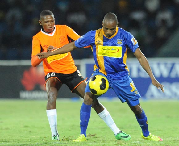 Olekantse Mambo of Orapa United and Jerome Ramatlhakwana of Township rollers during the Mascom Top8 final at the Francistown Stadium in Botswana on 23 April 2016. Monirul Bhuiyan/Backpagepix