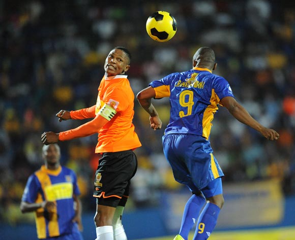 Olefile Magetse of Orapa United and Jerome Ramatlhakwana of Township Rollers during the Mascom Top8 final at the Francistown Stadium in Botswana on 23 April 2016. Monirul Bhuiyan/Backpagepix